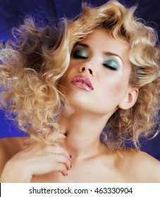 young blonde woman with glamour makeup and hairstyle waves close up, pink lipstick
