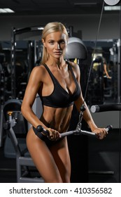 Young blonde woman in gym