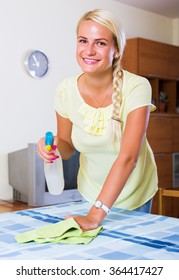 Young blonde woman having regular clean-up in home interior
