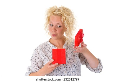 Young blonde woman holding a red gift in her hand