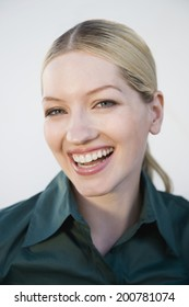 Young blonde woman laughing portrait