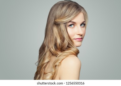 Young blonde woman with long healthy hair, spa beauty portrait