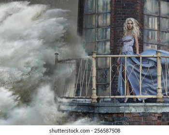 Young blonde woman on the sea storm