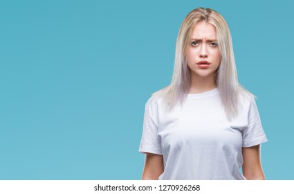 Young blonde woman over isolated background skeptic and nervous, frowning upset because of problem. Negative person.