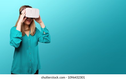 young blonde woman with pink lips with a virtual reality glasses