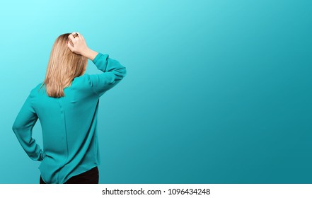 young blonde woman with pink lips back pose. thinking