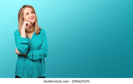 young blonde woman with pink lips thinking or doubting