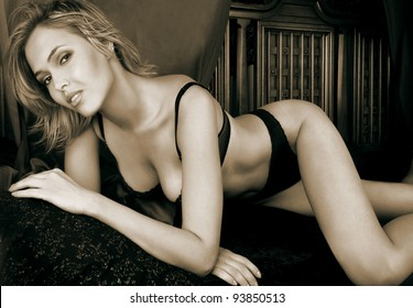a young blonde woman posing in her bedroom