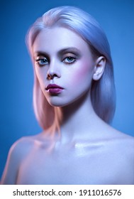 Young blonde woman posing with nude makeup and healthy beautiful skin. Studio portrait