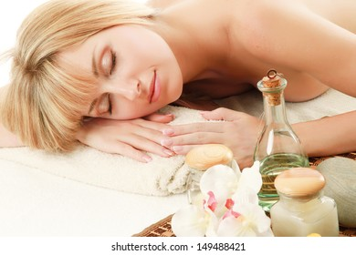Young blonde woman at spa procedure