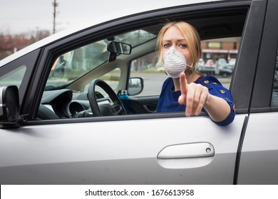 A young blonde woman in the Washington, D.C. area prepares to go to a drive through coronavirus testing center to take a COVID-19 test.