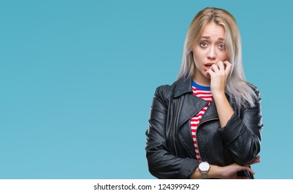 Young blonde woman wearing black jacket over isolated background looking stressed and nervous with hands on mouth biting nails. Anxiety problem.