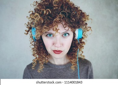 Young blonde woman wearing blue headphones