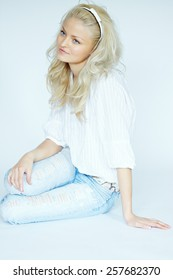 Young blonde woman wearing jeans and white blouse. Some images in the series are shot with tilt-and-shift lens.
