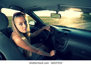 young blonde women in the car