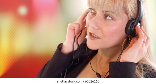 Young blondie woman listening music on headphone