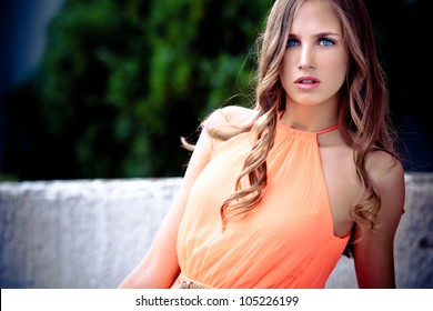 young blue eyes blond woman outdoor summer portrait