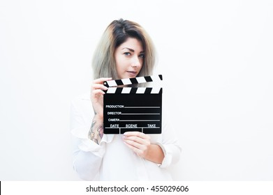 Young blue eyes blonde woman actress audition with movie clapper on white background