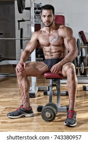 Young bodybuilder in Fitness center
