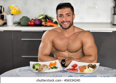 young bodybuilder in the kitchen, smiling, with two plates of healthy food: rice, chicken grill, broccoli, carrots, mushrooms, salmon, tomato, red peppers, potatoes