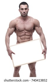 Young bodybuilder posing with blank board in front of white background