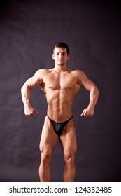 young bodybuilder posing in studio