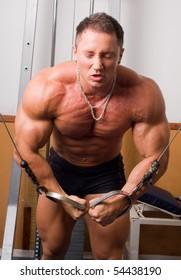 young bodybuilder training in gym