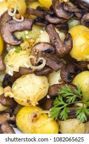 young boiled potatoes with dill, garlic and mushrooms