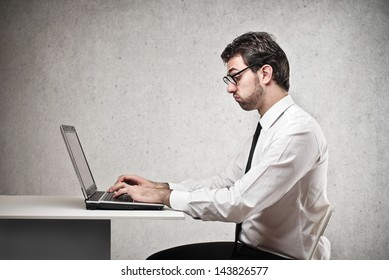 young bored businessman working