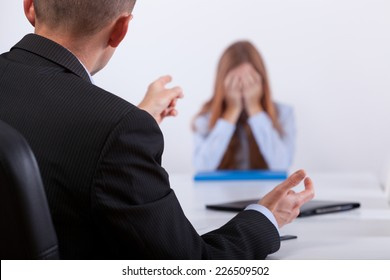 Young boss bullying the candidate in her job meeting