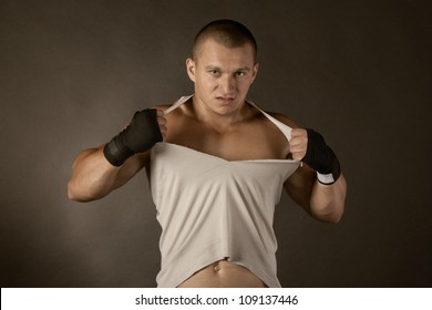 Young Boxer fighter over black, shirt rip to shreds
