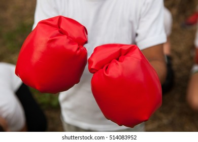 Young boxer with red boxing gloves.