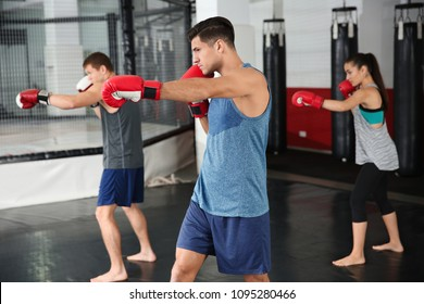 Young boxers warming up before training in gym