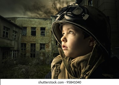 Young boy alone  in a war zone