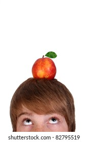 young boy with an apple on his head