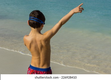 Young Boy with Back to Camera Points to the right
