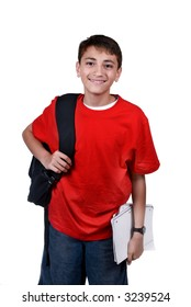 A young boy with a backpack ready for school. Isolated on white.