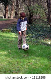 Young boy with ball in the park