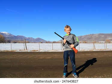 Young boy with a bb gun.