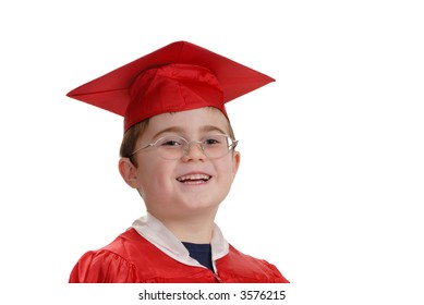Young boy with big smile in red graduation cap and gown, horizontal, isolated on white