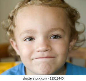 Young boy with big smile or smirk on his face