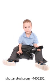 Young boy with black phone