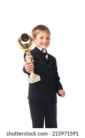 Young boy in the black suit holding trophy isolated on white