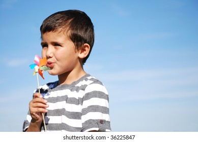 Young boy blowing windmill