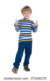 Young boy in blue pants holds his thumbs up on the white background