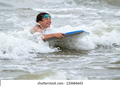 Young boy with a bodyboard on the beach