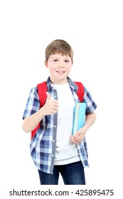 Young boy with books and backpack on a white background