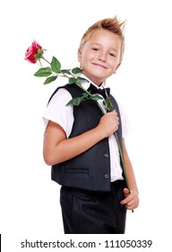 Young boy in bow tie and suit holding rose on his shoulder