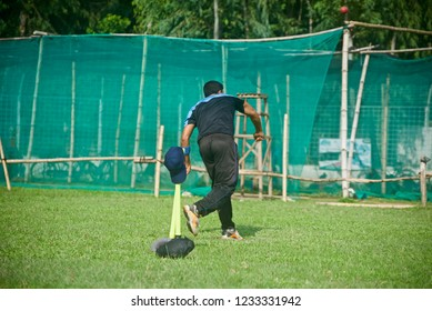 Young boy bowling around a cricket ground unique photo