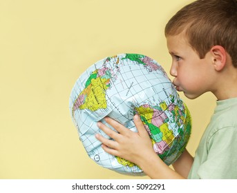 young boy breathing life back into a deflating planet earth